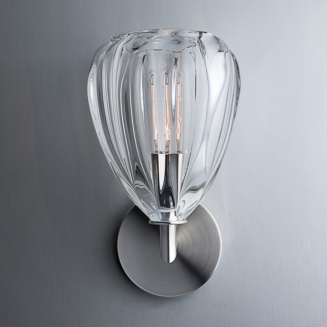 Hand Blown Glass Lighting. clear barnacle elbow sconce by siemon and salazar