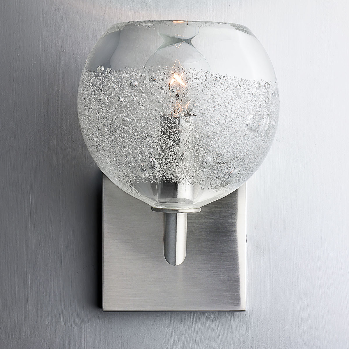 Hand Blown Glass Lighting. clear round bubble elbow sconce by siemon and salazar