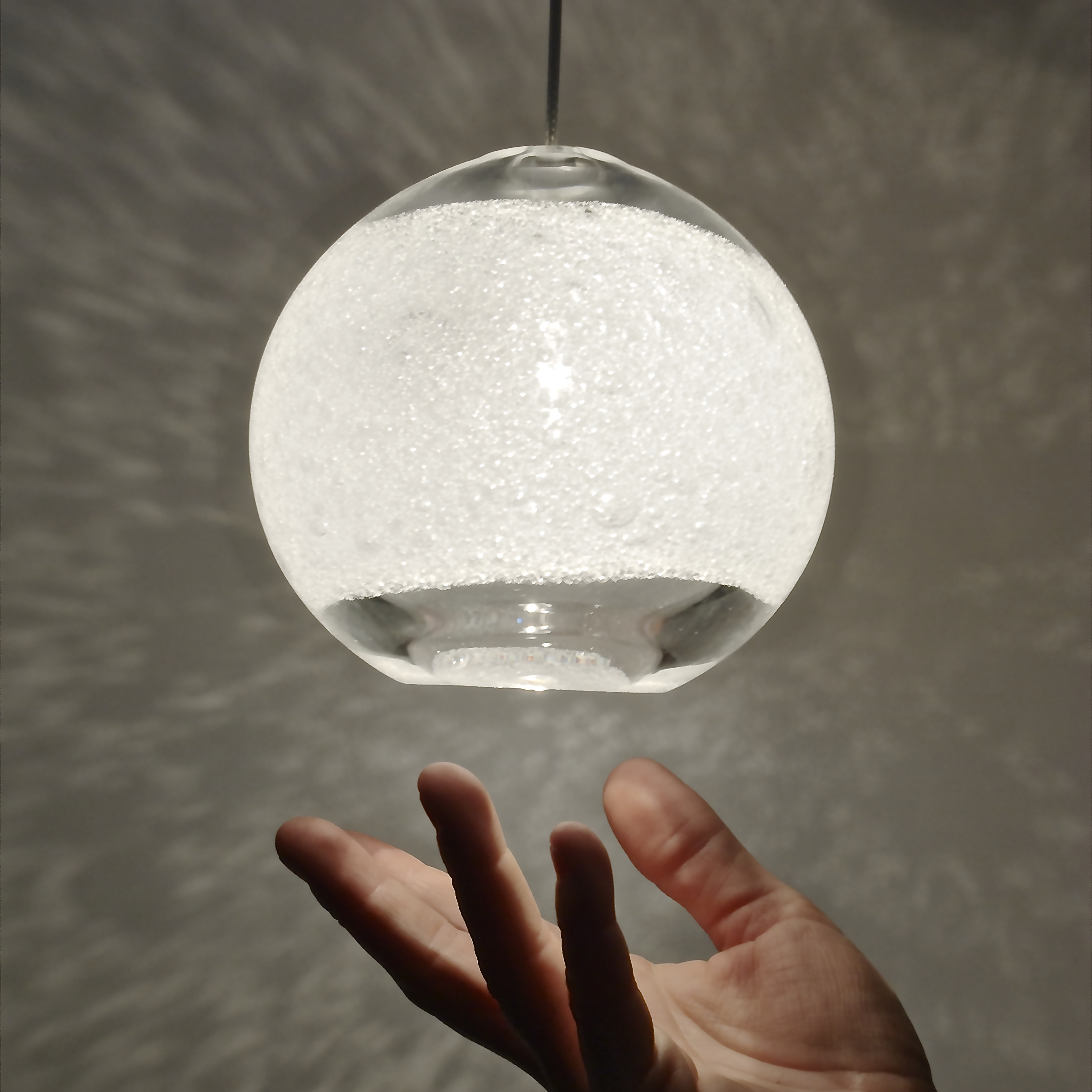 Hand Blown Glass Lighting. clear bubble orb light by siemon and salazar