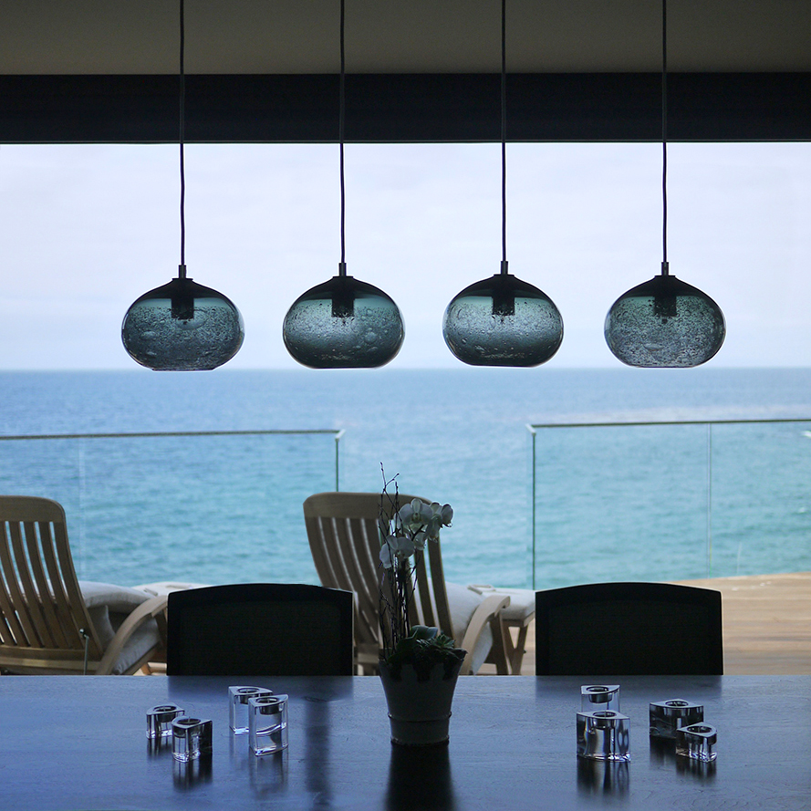 Hand Blown Glass Lighting. grey ellipse bubble pendant by siemon and salazar